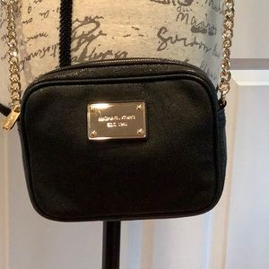 Michael Kors Bags - Michael Kors black and gold crossbody